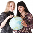 Stock Photo: Two beautiful girls with globe