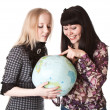 Two beautiful girls with the globe - Stock Photo