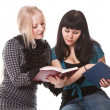 Two beautiful girls with books - Stock Photo