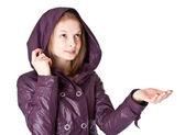 Girl in raincoat in the rain — Stock Photo