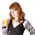 Beautiful girl with juice — Stock Photo