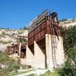 Old abandoned stone quarry machinery — Stock Photo