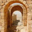 Converging ancient stone arches — Stock Photo