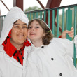 Mother and daughter in white cloaks — Stock Photo