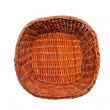 Brown wicker basket top view isolated — Stock fotografie
