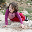 Little girl lies on the rock — Stock Photo