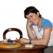 Smiling woman plays with wooden toys — Stock Photo #1173585