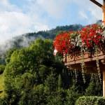Alpine chalet balcony with flowers — Stock Photo #1174088