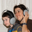Stock Photo: Mother and boy listen to music