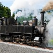 Historical steam engine on tracks — Stock Photo
