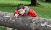 Cute little boy with sly expression — Stock Photo