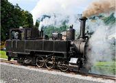 Historical steam engine on tracks — Stock Photo