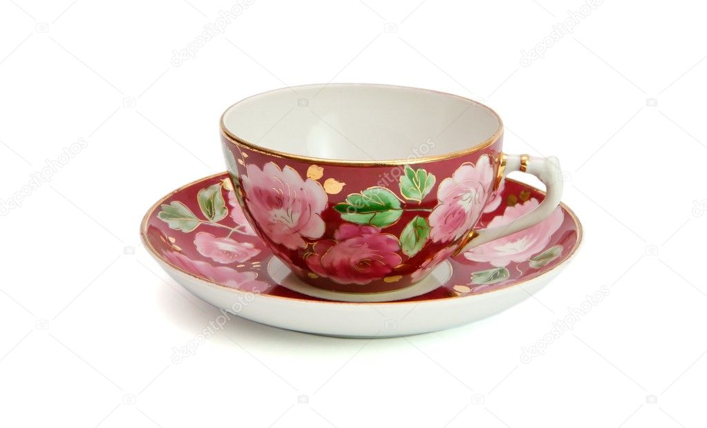 Tea cup and saucer with floral pattern isolated  — Stock Photo #1170343