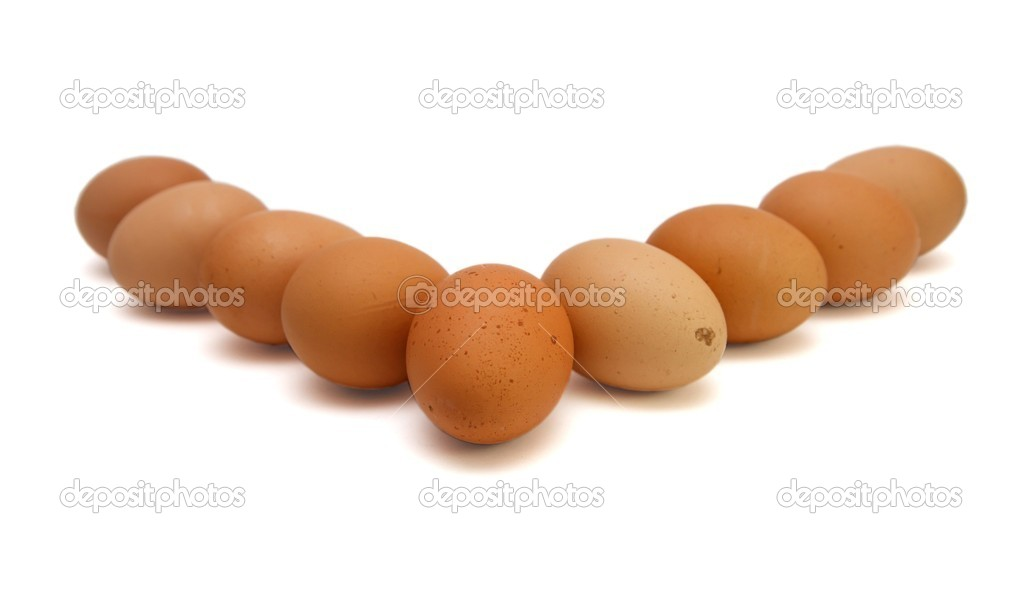 Wedge of nine brown eggs isolated  Stock Photo #1171854