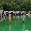 Wooden boat houses on green lake — ストック写真