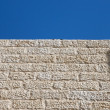 Upward view of gray stone wall — Stock Photo
