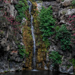 Stock Photo: Waterfall on black basalt rocks