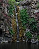 Waterfall on black basalt rocks — Stock Photo