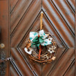 Dry old wreath on brown wooden door — Stock Photo #2058349
