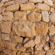 Convex ancient stone wall texture - Stock Photo