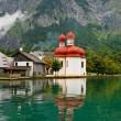 St. Batholomew Church on Alpine lake — Stock Photo #2064061