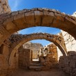 Stock Photo: Converging ancient stone arches
