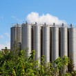 Twelve tower silos on chemical plant - Stock Photo