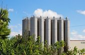 Twelve tower silos on chemical plant — Stock Photo