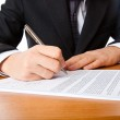 Close up on a businessman hands signing — Stock Photo