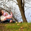Stock Photo: Mother and daughter in a park
