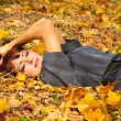 Womis lying in leaves — Stock Photo #1240054