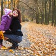 Mother and daughter in a park — Stock Photo