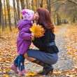 Mother and daughter in a park — Stock Photo #1240130