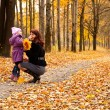 Mother and daughter in a park — Stock Photo #1240145