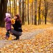 Mother and daughter in a park - 
