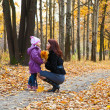 Mother and daughter in a park — Stock Photo #1240158