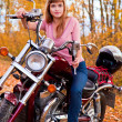 Young beautiful girl on motorcycle — Stock Photo