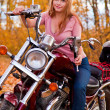 Stock Photo: Young beautiful girl on motorcycle