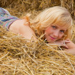 Woman laying on a straw — Foto de stock #1251110
