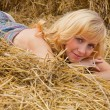 Woman laying on a straw — Stock Photo #1251110
