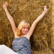 Woman laying on a straw — Stockfoto