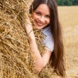 Woman and straw — Stock Photo #1251122