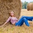 Woman laying on a straw — Foto de Stock