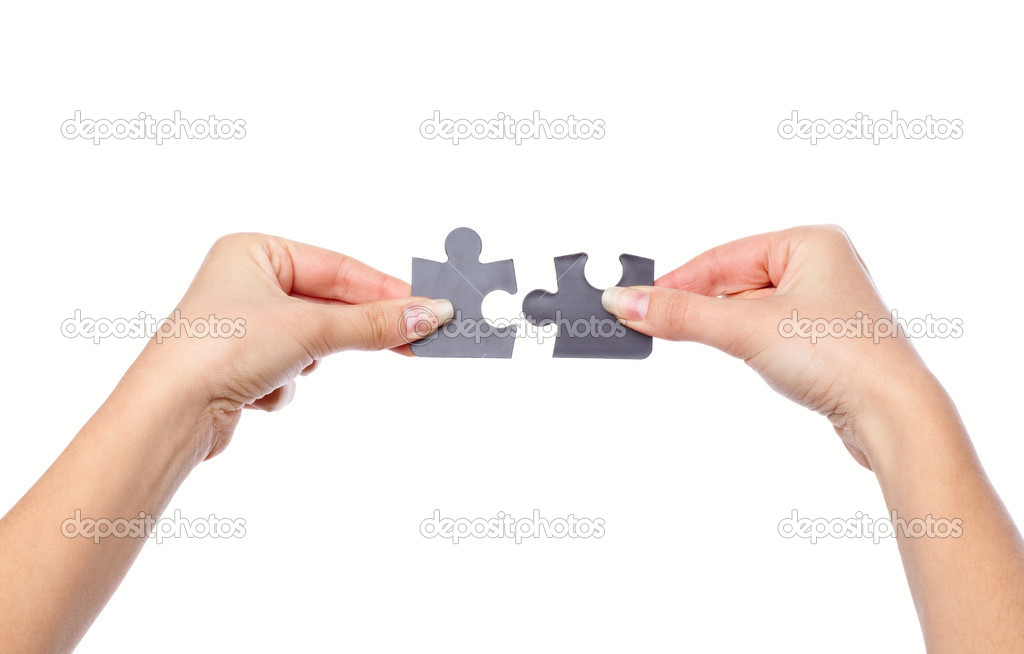 Hands with two puzzles. Isolated on white background — Stock Photo #1250024