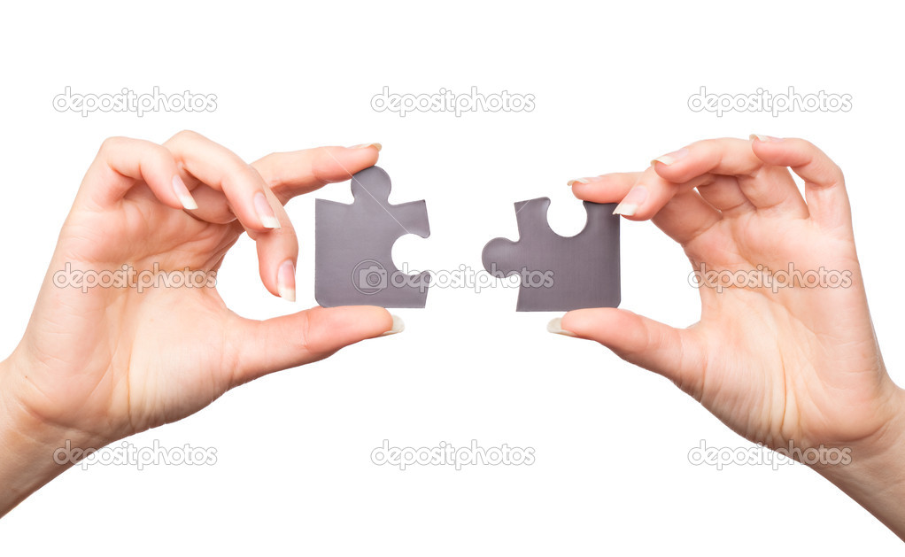 Hands with two puzzles. Isolated on white background — Stok fotoğraf #1250034