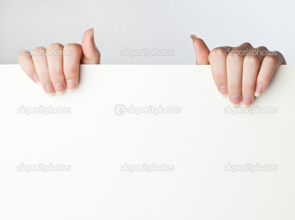 Sheet and hands on grey background — Stock Photo #1250049