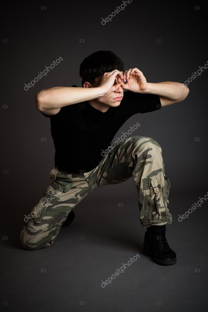 Man in uniform on gray background — Stok fotoğraf #1250180