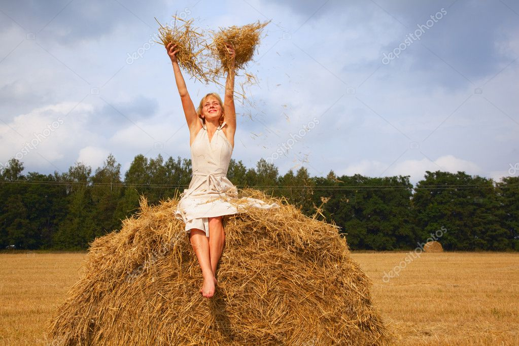 Young beautiful woman laying on a straw — Stock Photo #1251073