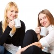 Two teenage girls is drinking tea — Stock Photo #1284233