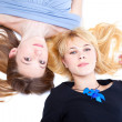 Two girls is lying on a floor. Isolated — Stock Photo
